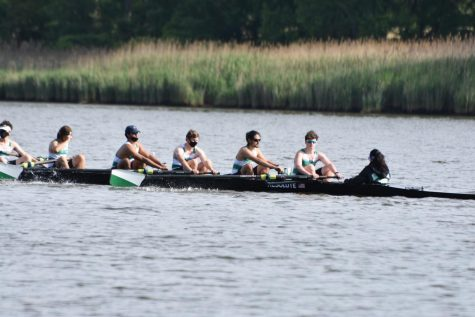 Sophomore Nathan Henderson (middle) rows with his teammates in the Gunston Regatta. This event was the final race of the crew season for novices on the team, as well as others who didn't qualify for the national Regatta.