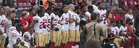 Some members of the San Francisco 49ers kneel during the National Anthem before a game against the Washington Football Team in 2017 in Landover, Maryland.