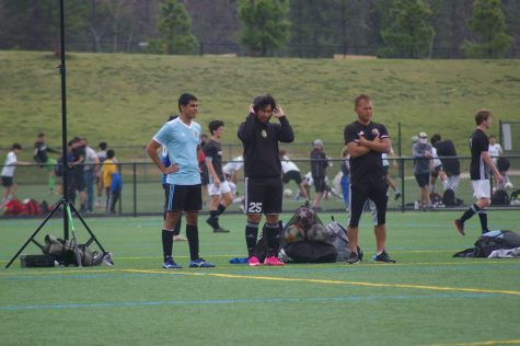 Oscar Guerro watches his team from the sidelines of their final Jefferson Cup game. Guerro started coaching his first son Diego 15 years ago. This is his second team for his second son Anderson.