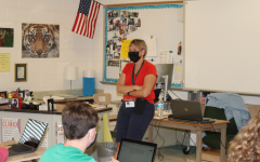 English teacher Jenelle Ryan leads her classroom behind a mask. Its been a challenge this year, but Ryan has enjoyed being back in the classroom with her students.