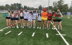 Varsity volleyball shows off their spirit at the fall pep rally. Team captains determined the spirit theme, and players really enjoyed dressing up to show their team pride.