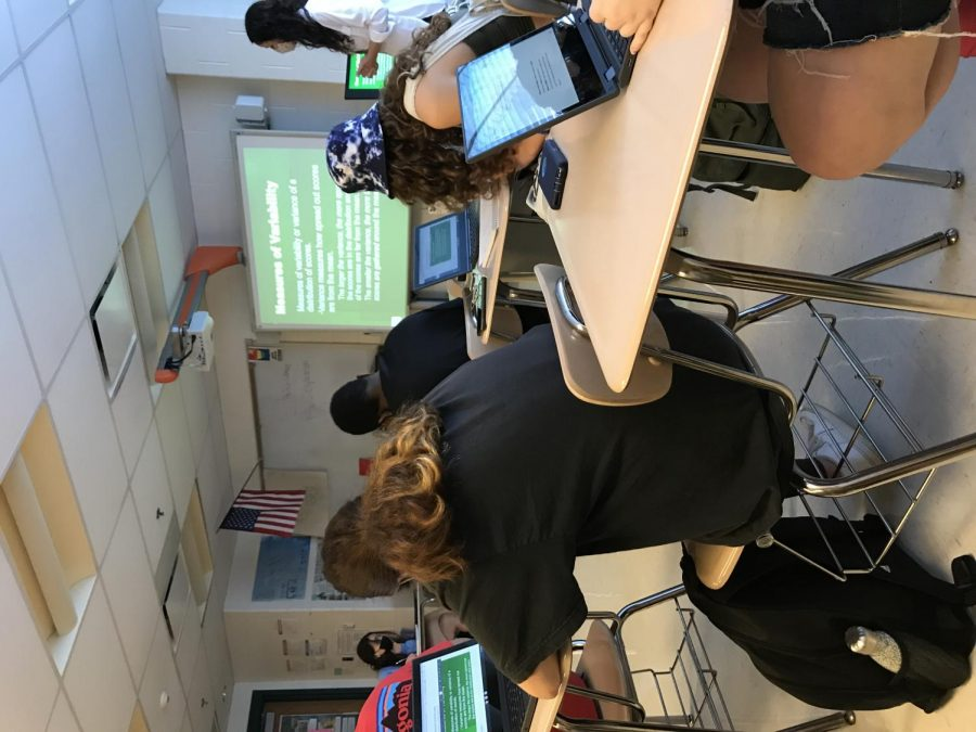 Social studies teacher Nicole McCarn teaches her second period AP Psychology class on Sept. 15.  Like many of her colleagues during the first week of school, McCarn offered her students a chance to write their pronouns and preferred name on a name cards on their desks. This was part of the MCPS push to provide transgender and nonbinary students an easier way to come out to teachers.