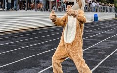 WJs Wildcat mascot welcomes students as they arrive at the years first pep rally. For many underclassmen, this was their first pep rally ever. Even juniors only attended a few during their freshmen/last year in person.