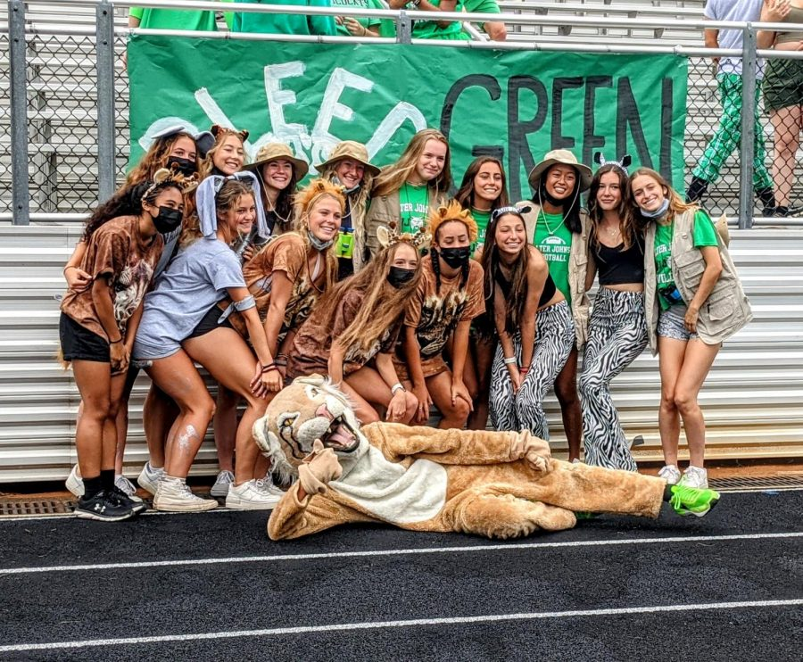The WJ girls varsity soccer team poses for a picture after the pep rally. Quarantine has been particularly hard on athletes who thrive on social interaction with their teammates and coaches. Being back at school has been a blessing for many student-athletes.