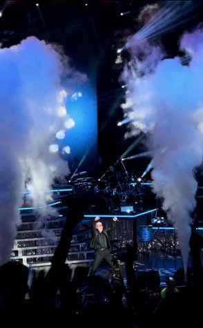 Pitbull is on stage screaming to the crowd as he brings his exciting performance to Merriweather Post Pavillion. Students in attendance weighed the risks associated with Covid exposure with the reward of attending a live show.