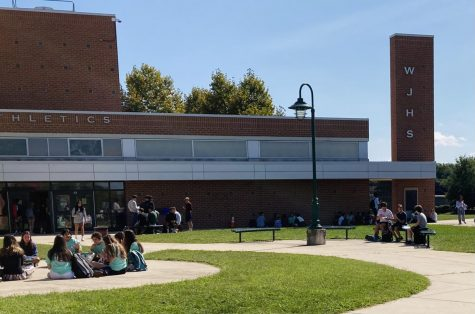 Students enjoy lunch outside of the school building while the weather is seasonal. Having open lunch allows for more free [time] freshman Timmy Gaul said.