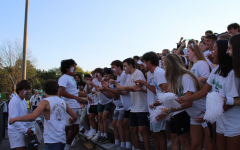 Walter Johnson students cheer on the WJ football team at the first game of the season. The game took place at Churchill High School on September 8.
