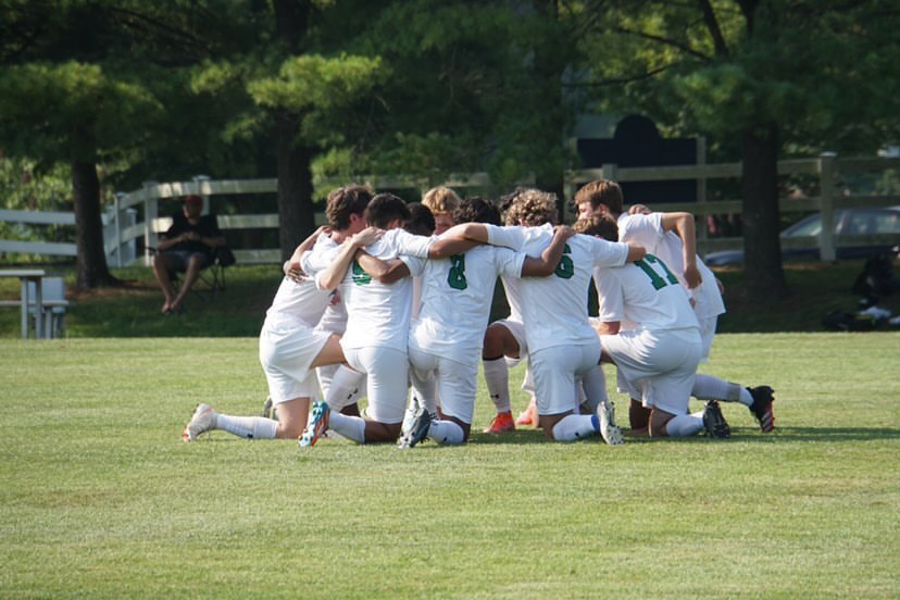 WJ+soccer+huddles+up+prior+to+the+2021+season.+They+finished+with+a+3+game+win+streak+last+season+and+look+to+keep+it+up.