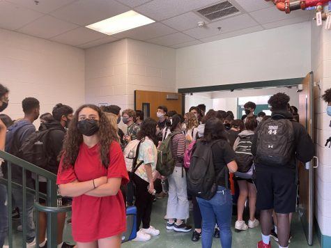 Walter Johnson students wade through the crowded stairwells trying to get to class. Many find the slow, jammed hallways a difficult adjustment, especially after distancing for so long.