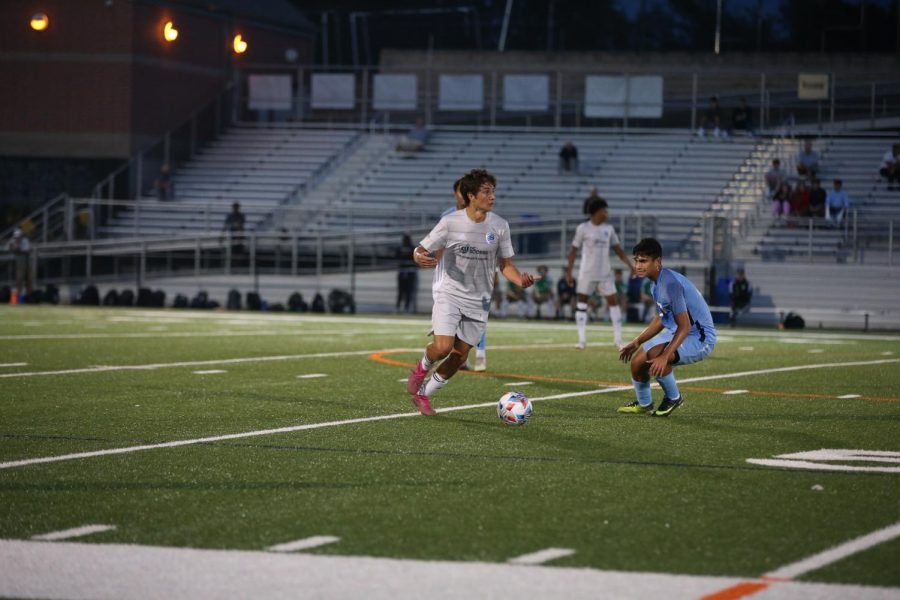 Senior Connor Muchetti looks to beat his defender and advance the ball past midfield. Muchetti hopes to continue his face-paced play throughout his next four years at St. Johns University.
