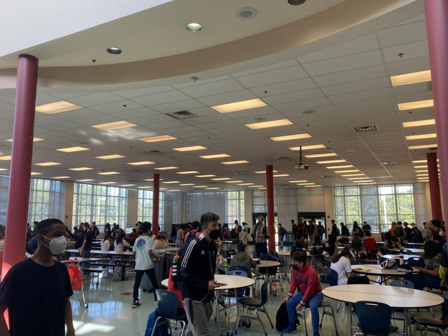 The long lunch line wraps around the cafeteria. Students make use of the free lunch that the county is currently providing due to Covid.