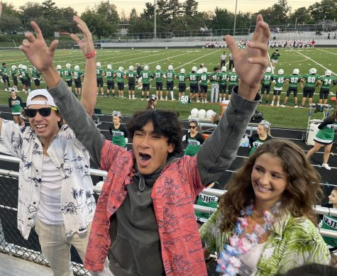 From left: Seniors JP Rakis, Alejandro Linares and Sofia Orezzoli muster up some energy to hype up the crowd before kickoff. Drumless, they still were able to succeed in doing so.