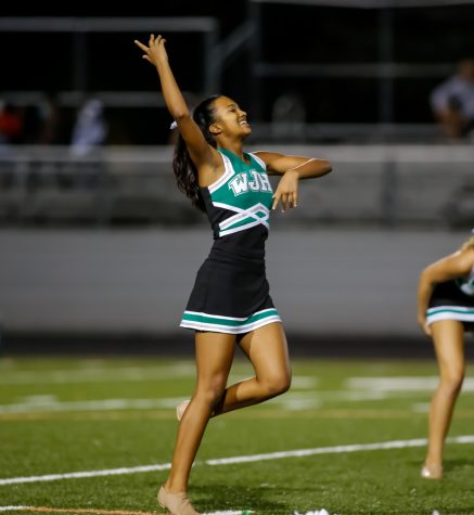 Sophomore Madison Fraser finishes her first homecoming game performance with Poms. This performance was a longer version of their usual routine and was a crowd favorite.
