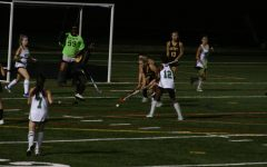 Lily Delp plays aggressive offense against RM. She would finish the game with a 4 goal haul.
