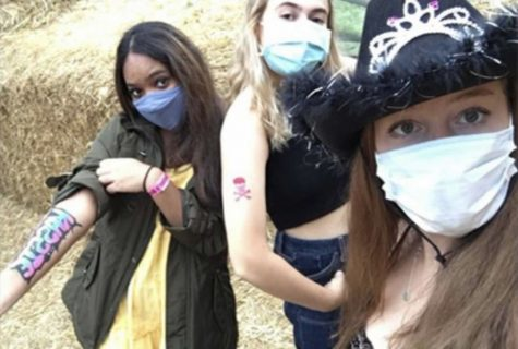 Seniors Shalawn Pasard, Alexa Cerrud, Kyra Lee show off their tattoos. The three partook in the fall festivities at Butlers Orchard.