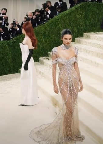 Model Kendall Jenner poses for the paparazzi in a dress by Givenchy. The look was inspired by Audrey Hepburns dress in My Fair Lady. This is Jenners seventh year attending the Met Gala.