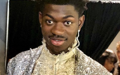 Lil Nas X gets ready backstage at the 2019 MTV Music Video Awards. Lil Nas X blew up following the success of Old Town Road, a song that combined elements of country and rap to create a hit with cross genre appeal.