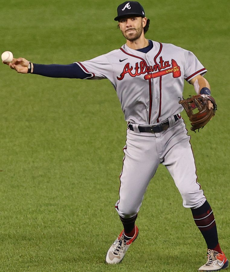 Shortstop Dansby Swanson of the Atlanta Braves fields a ground ball. Swanson has played a key role in Atlantas surprise run to the NLCS this year both in the field and at the plate.