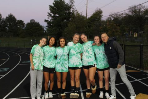 From left to right: Seniors Sydney Stein, Madeline Chung, Emma Kothari, Charlotte Thomas, Rachel Rinehart and Abby Calhoun post with Coach Joshua Kinnetz just before their ceremony. Ive been one of Kinnetzs players for 4 years now. We have developed a great player-coach relationship, Stein said.