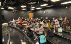 Walter Johnson S*T*A*G*E students sit together and prepare for their upcoming fall show. In-person school has returned after nearly two years of online rehearsals.
